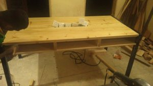 Pine wood office table, metal framework, with swiches embeded. simple clean table with rack space.