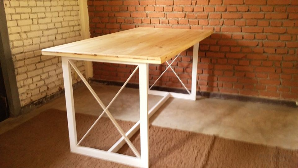 Metal framework and pinewood top Table