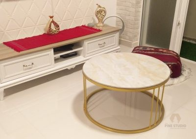 Substantial in size yet delicate in appearance, Akbar Coffee Table features a beige top with a bronze hourglass metal fretwork base that is a beautiful combination of size and grace.